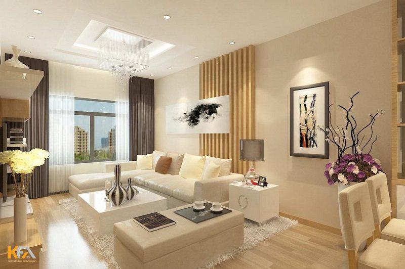 Nằm ở chiếc ghế sofa, bạn có thể ngắm nhìn vẻ đẹp của mẫu trần thạch cao chung cư cùng với chiếc đèn chùm lung linh